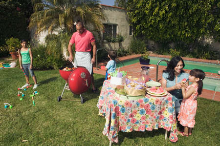 barbequing: Hispanic family barbequing LANG_EVOIMAGES