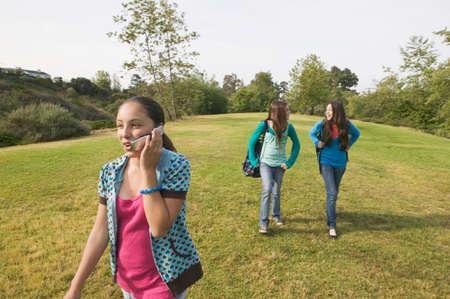 talker: Hispanic teenaged girls in park