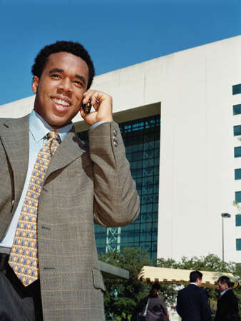 skepticism: African American businessman talking on cell phone