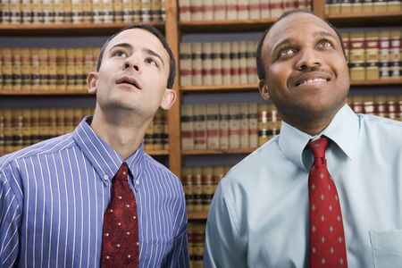 paralegal: Multi-ethnic businessmen looking up