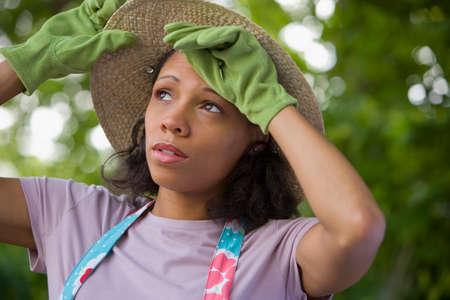 gardening gloves: African American woman wearing gardening gloves