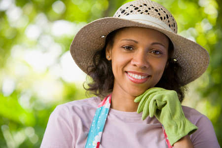 seriousness skill: African American woman wearing gardening glove