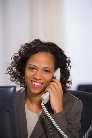 milepost: African American businesswoman talking on telephone LANG_EVOIMAGES