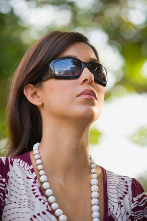 recuperating: Hispanic woman wearing sunglasses