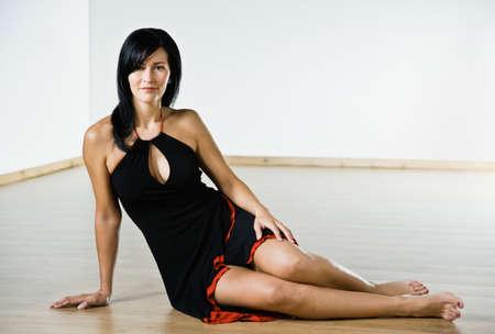 relishing: Hispanic woman sitting on floor