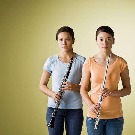 kinfolk: Asian girls holding wind instruments LANG_EVOIMAGES