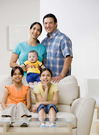 family sofa: Portrait of multi-ethnic family LANG_EVOIMAGES
