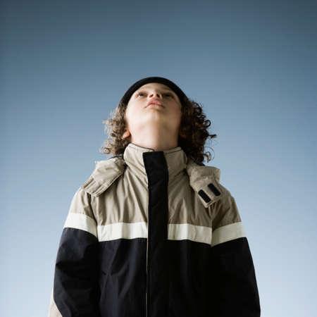 cubby: Hispanic boy in jacket looking up