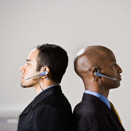 egocentric: Multi-ethnic businessmen wearing headsets LANG_EVOIMAGES