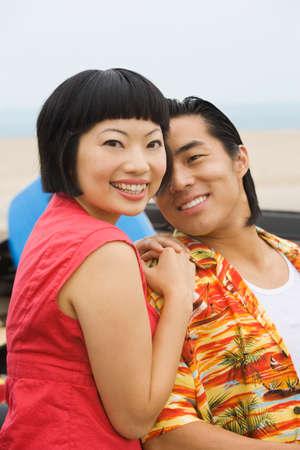 honeymooner: Asian couple hugging LANG_EVOIMAGES