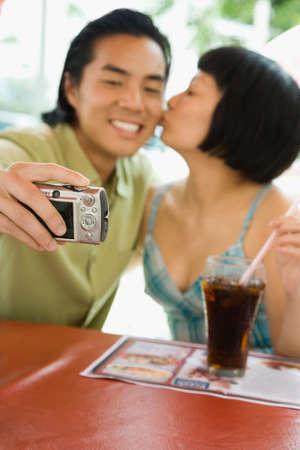 relishing: Asian couple taking own photograph