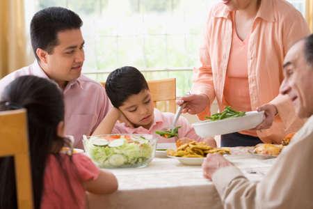 eating area: Hispanic family at dinner table