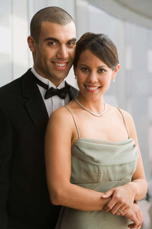 'evening wear': Hispanic couple in evening wear LANG_EVOIMAGES