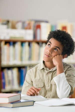 Hispanic boy studying in library