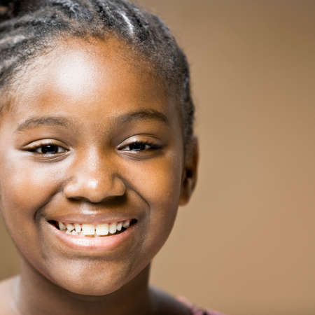 liable: Close up of African girl smiling