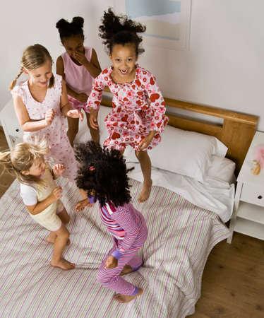 slumber party: Multi-ethnic girls having slumber party LANG_EVOIMAGES