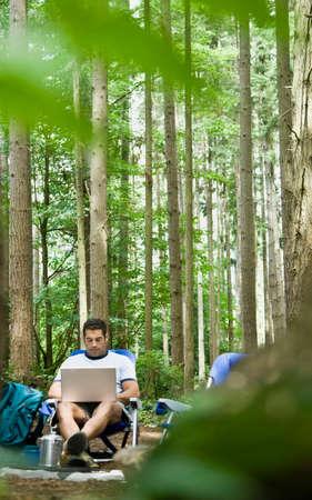 adventuresome: Hispanic man typing on laptop