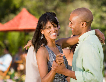1 woman only: African American couple dancing outdoors