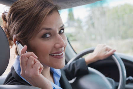 acknowledging: Hispanic businesswoman talking on cell phone