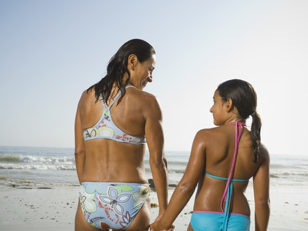 Hispanic mother and daughter holding hands Stock Photo