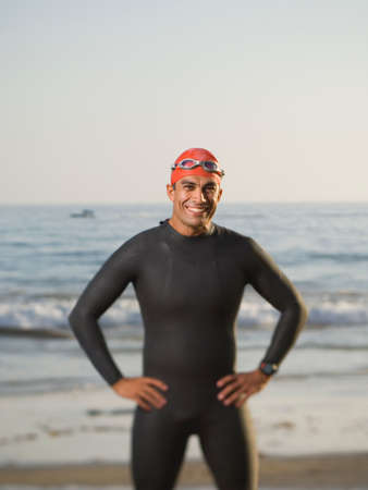 attired: Hispanic man wearing wetsuit and goggles