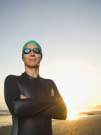 attired: Hispanic woman wearing wetsuit and goggles LANG_EVOIMAGES