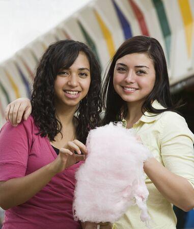 teenaged girls: Multi-ethnic teenaged girls eating cotton candy