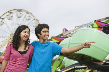 Multi-ethnic teenaged couple at carnival