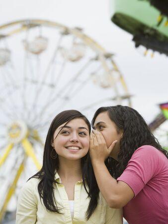 Multi-ethnic teenaged girls telling secret Stock Photo