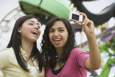 teenaged girls: Multi-ethnic teenaged girls taking own photograph