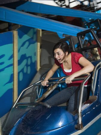 teenaged girl: Mixed Race teenaged girl on carnival ride LANG_EVOIMAGES