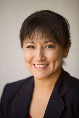 bathingsuit: Portrait of Hispanic businesswoman