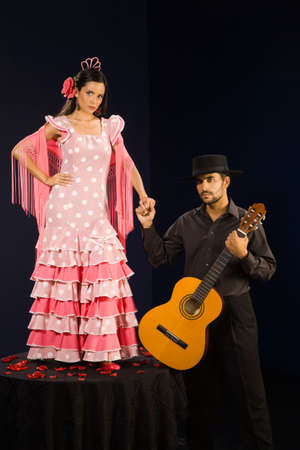 lust: Hispanic female flamenco dancer holding hands with guitar player