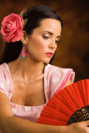sexy latina: Hispanic woman wearing flower in hair