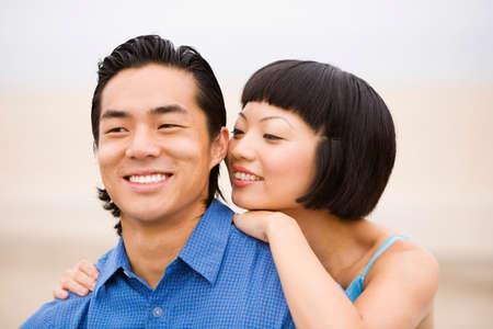 talker: Asian couple hugging LANG_EVOIMAGES