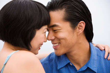 gusto: Asian couple smiling at each other