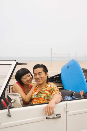 honeymooner: Asian couple sitting convertible