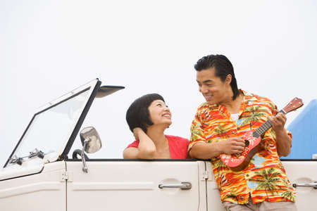 honeymooner: Asian couple smiling at each other