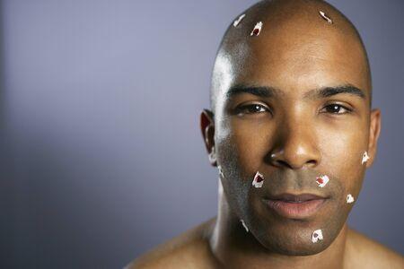 bathtowel: African American man with shaving cuts