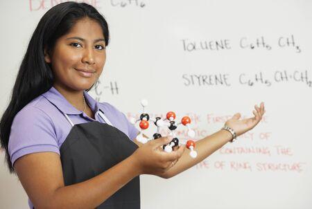 teenaged girl: Hispanic teenaged girl in science class