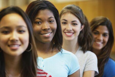 teenaged: Multi-ethnic teenaged girls in row