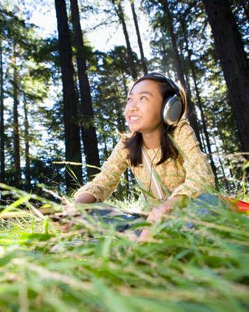 wooing: Asian girl listening to headphones