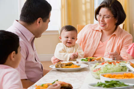 senior eating: Hispanic family at dinner table