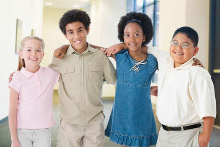 wearying: Multi-ethnic children standing arm in arm