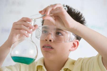 Hispanic boy in science class