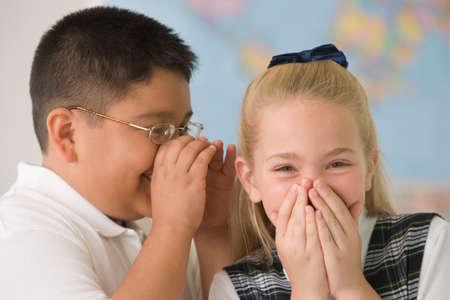 blabbing: Multi-ethnic children telling secret LANG_EVOIMAGES