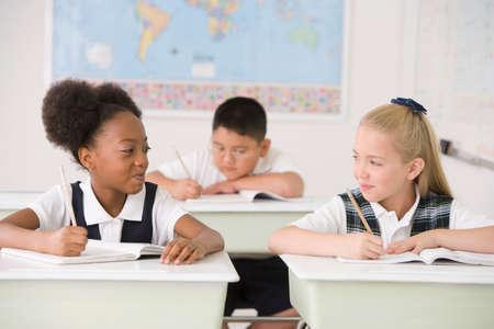 devilment: Multi-ethnic girls in classroom