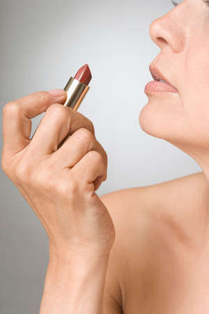 bathtowel: Hispanic woman holding lipstick