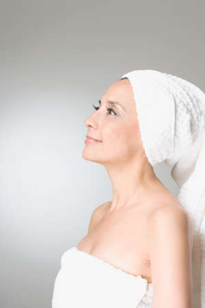 mid life: Hispanic woman wrapped in towels LANG_EVOIMAGES