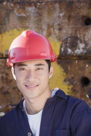 hardhat: Asian male construction worker wearing hardhat